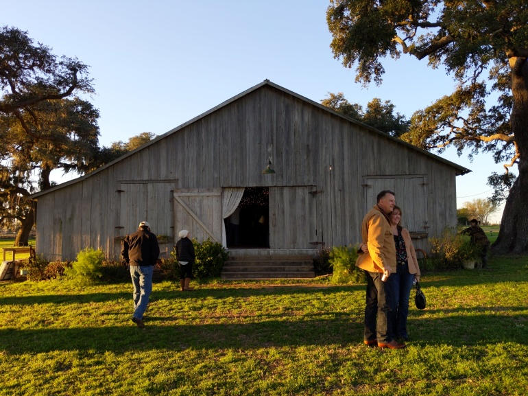 Old barn building now a wedding and party venue shown in the late afternoon sun