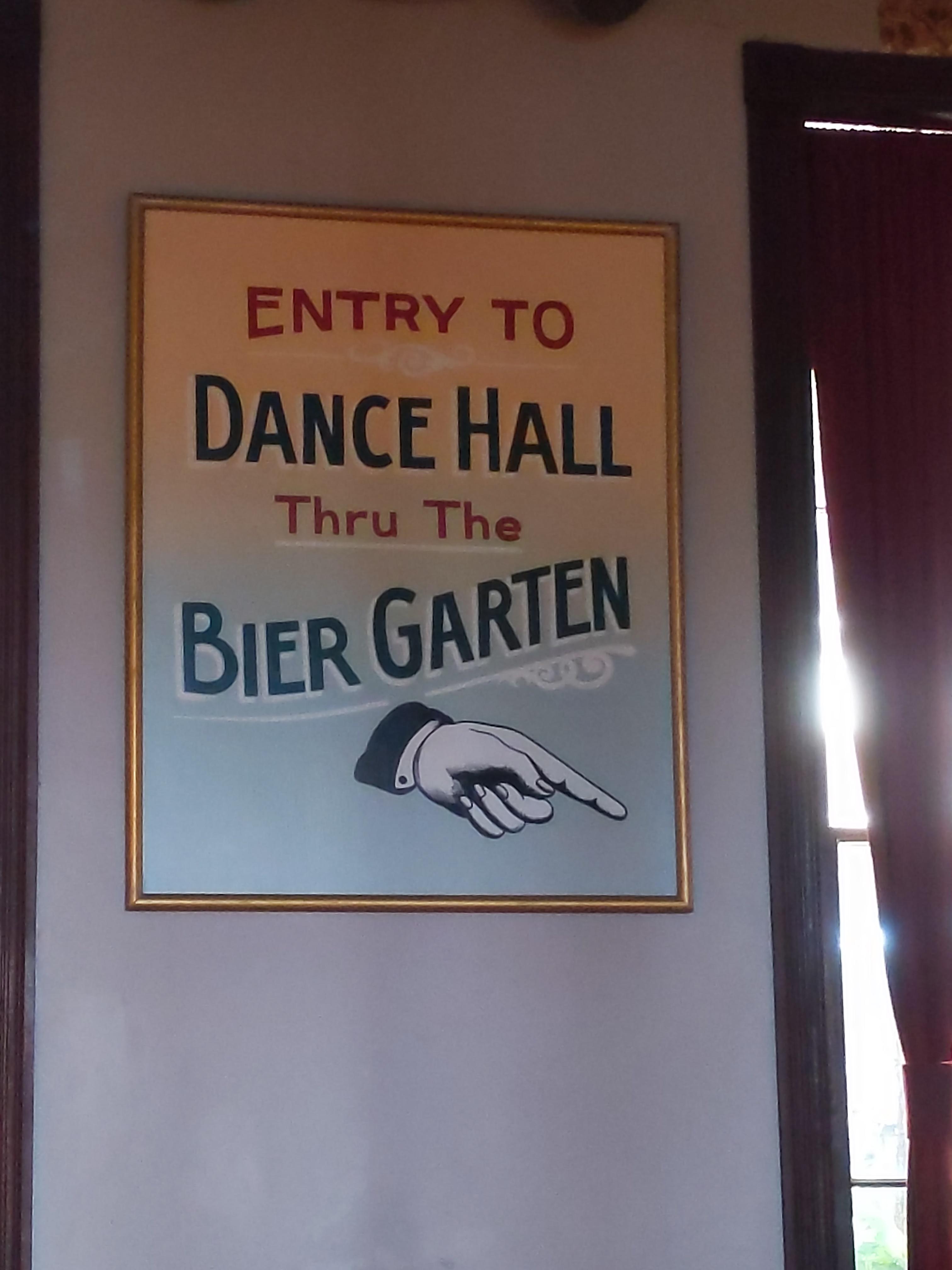 directional sign to dance floor